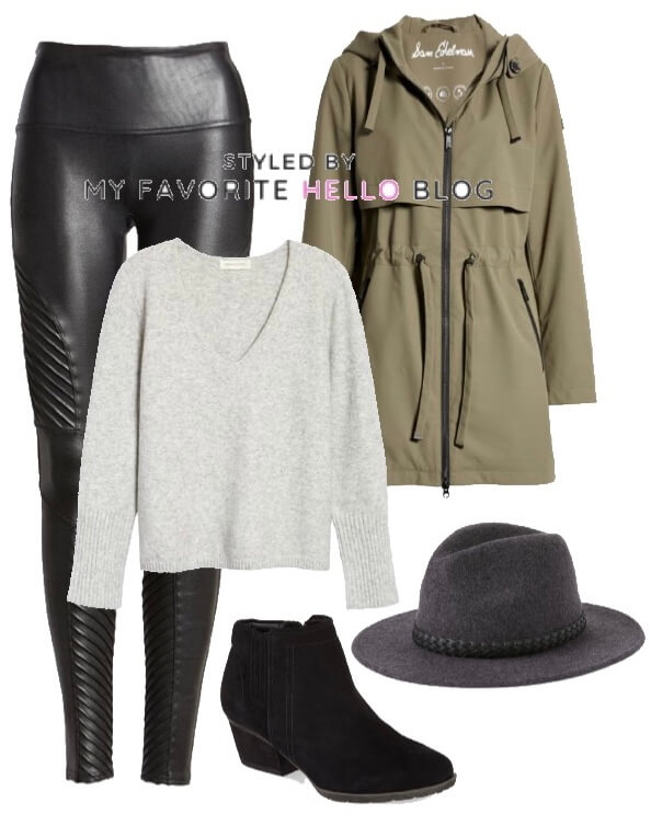 Black faux leather leggings and olive raincoat and wool hat