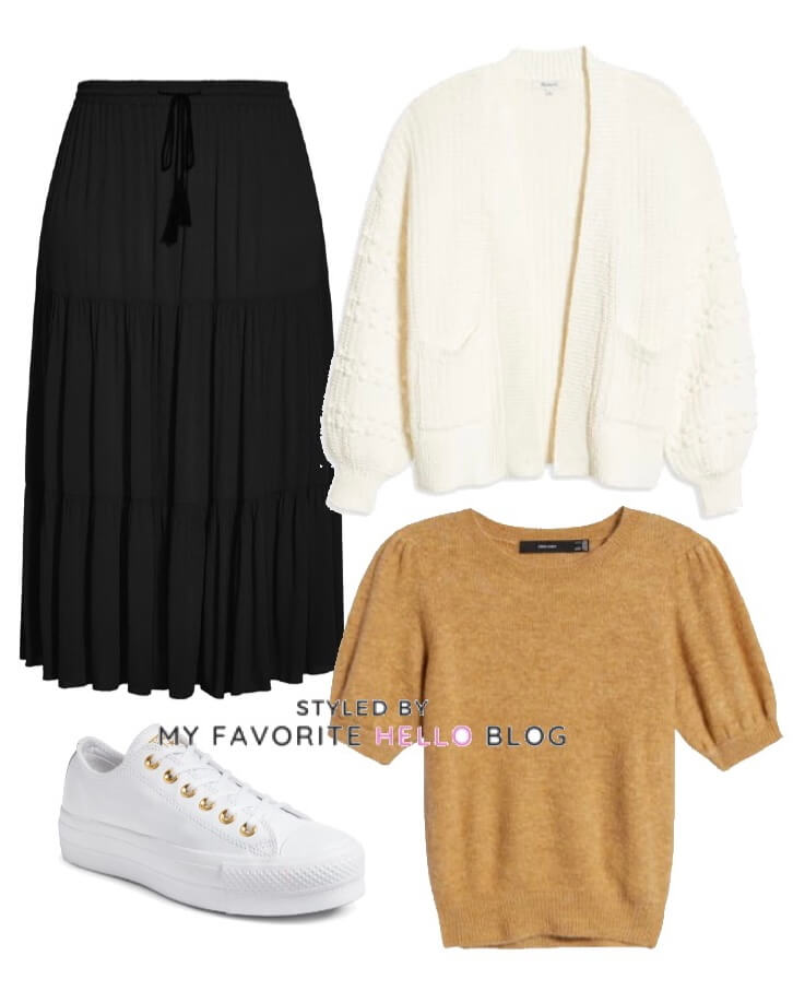 black skirt with white cardigan and white sneakers