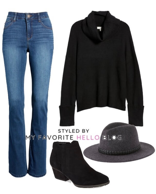winter outfit blue jeans with black sweater and wool hat